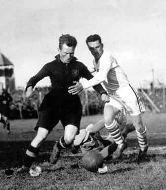 Bertram Patenaude (in white), against Belgium defender Nicholas Hoydonck. Patenaude would score the first hat trick in World Cup history four days later in a 3-0 victory over Paraguay.