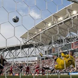 Sebastien Le Toux sends the winning goal past Toronto's Stefan Frei. (Photo: Daniel Gajdamowicz)