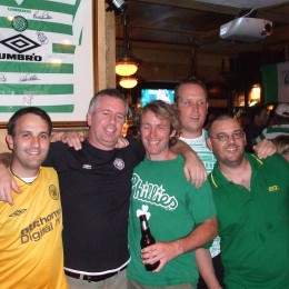 "Friends (l-r) Stanislaw Guzikowski, Gary ""Swing"" McDonald, Joe Falloon, and John MaCrae pose with an unamed Celtic fan who disappeared into the lost canyons of the night."