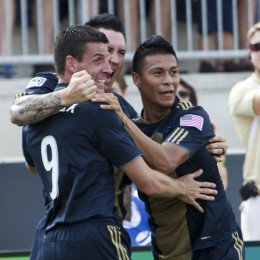 Michael Orozco, Danny Califf and Sebastien Le Toux celebrate a goal vs. Toronto. (Photo: Daniel Gajdamowicz)