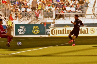 Sebastien Le Toux touches the ball past keeper Pat Onstad. (Photo: Paul Rudderow)