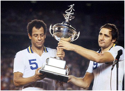Cosmos (Carlos Alberto (l) and Giorgio Chinaglia) host the 1978 NASL trophy after bullying their way through the season