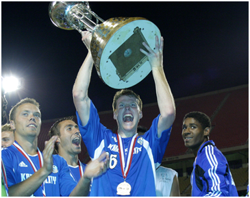 "2004 Kansas City Wizards Hold Their ""Best Ever Team"" Trophy (Resemblance to U.S. Open Cup merely coincidental)"