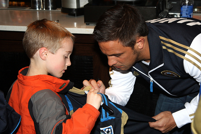 Daniel Cruz signing for a young fan