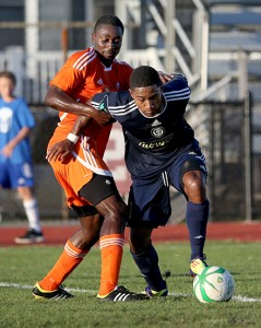 Darius Madison fights for space against Ocean City. (Photo Credit: Tom Boland)