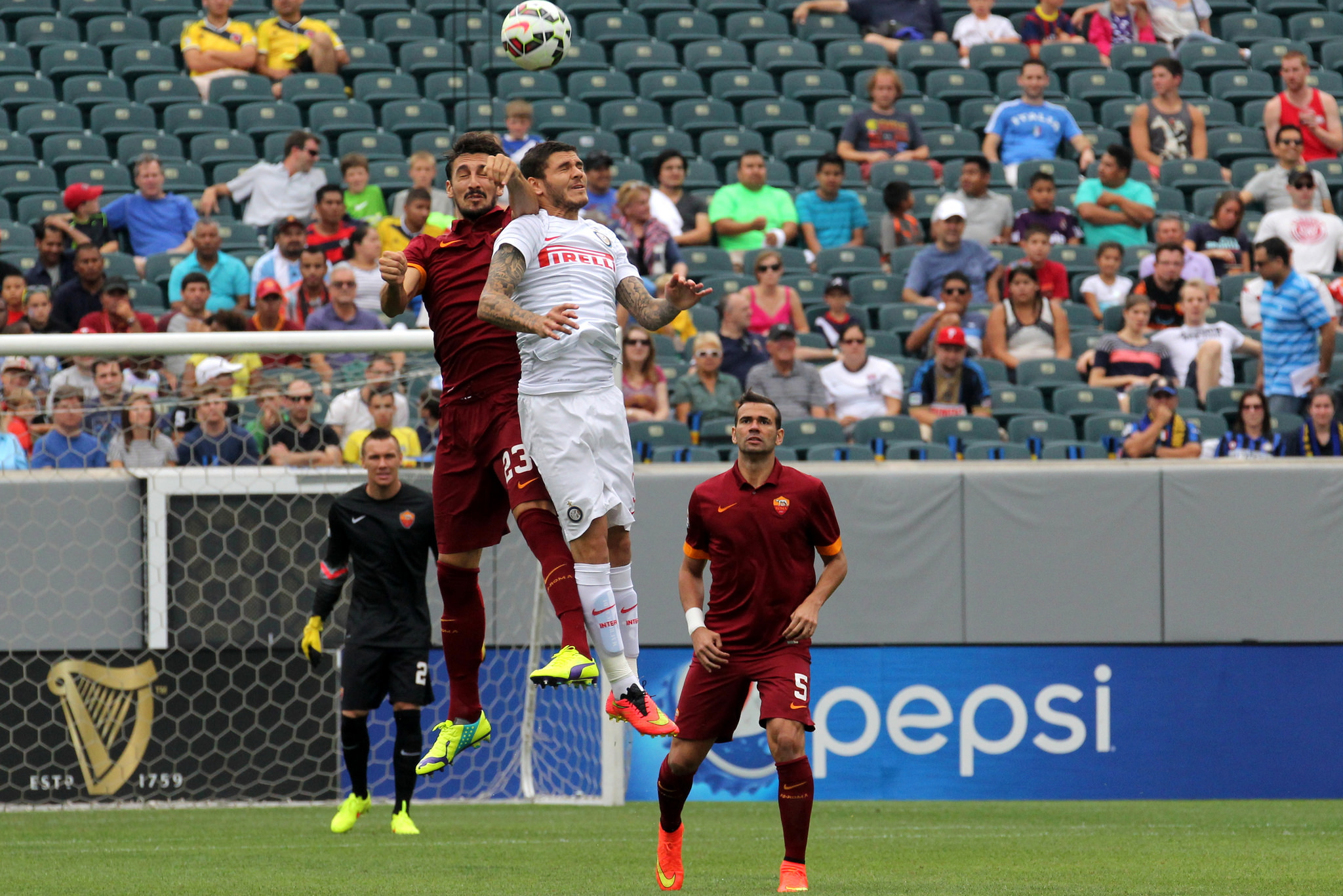 The opening match of the inaugural guinness inter national champions - Davide Astori And Mauro Icardi Battle In The Air