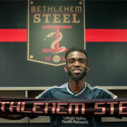 Steel sign center back Hugh Roberts