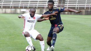 Seku Conneh contests the ball v Richmond
