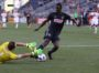 Cory Burke has a run at goal but gets dragged down by Richmond's keeper.